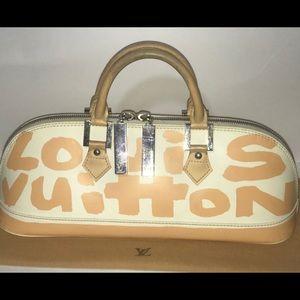 Authentic Louis Vuitton mini graffiti long Alma